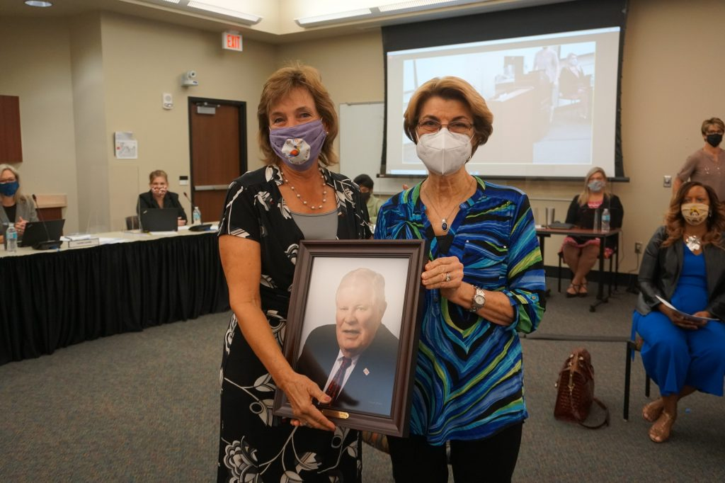 The Honorable Bernie McCabe's beloved wife receiving a plaque on behalf of Bernie