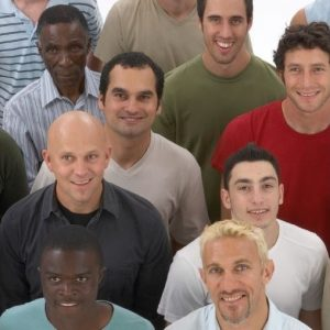 Photo of a group of diverse fathers, smiling